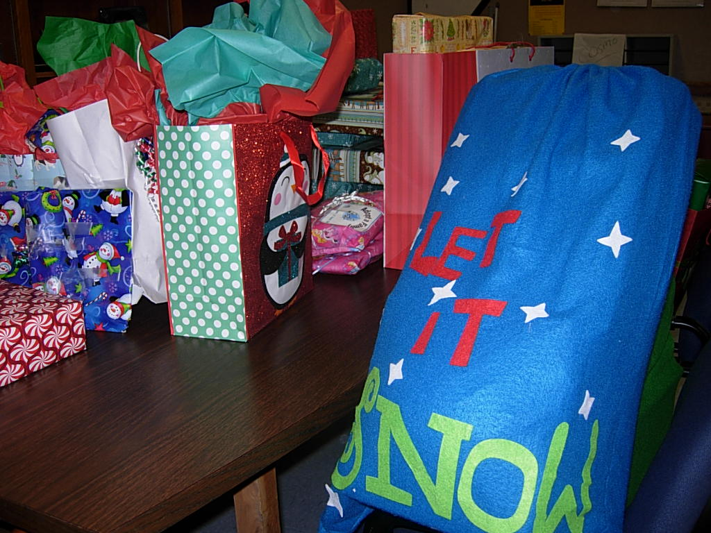 A Table Full of Gifts for STI's Annual Adopt-A-Family Program