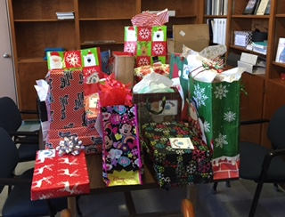 The Joy of Gift Giving Through STI's Adopt-a-Family Program