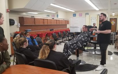Cosmetology Alum Returns to STI to Present a Men's Cutting Demonstration